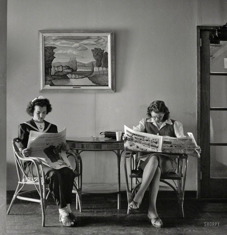 """May 1943. Arlington, Virginia. """"Reading the Sunday paper at Arlington Farms…"""