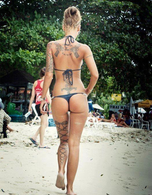 {Love the bow lace up on the back of her leg!!}  #hottieswithtattoos #tattoos #womenwithtattoos.... not lesbian at all but daaaamn she is hot! lol
