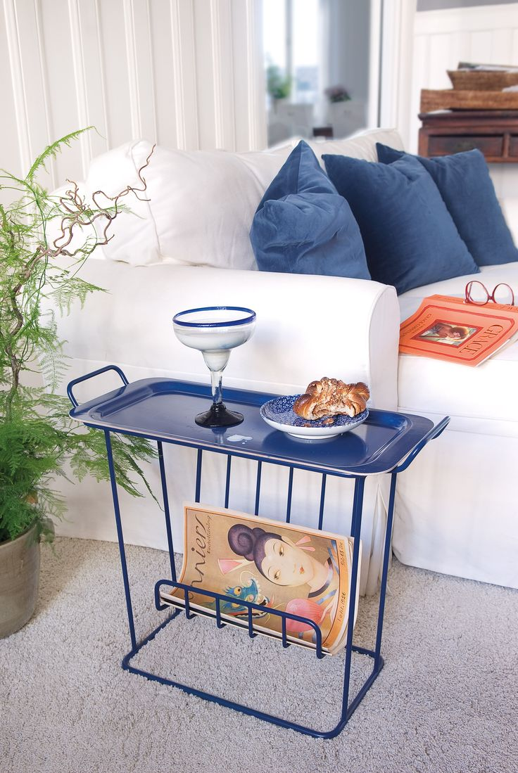 A side table to have next to the couch or bed. The table consists of a frame of metal wire with a loose tray in birch wood. Minnie Mae Paper is a versatile table where you can store your magazines and use as a side table.