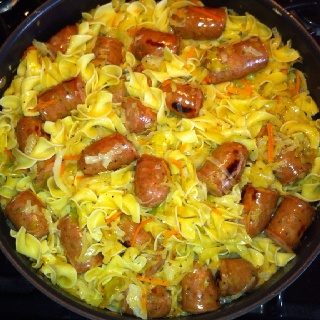 Polish Noodles w/Sausage. In a pan melt a stick of butter then add a bag of Cole…