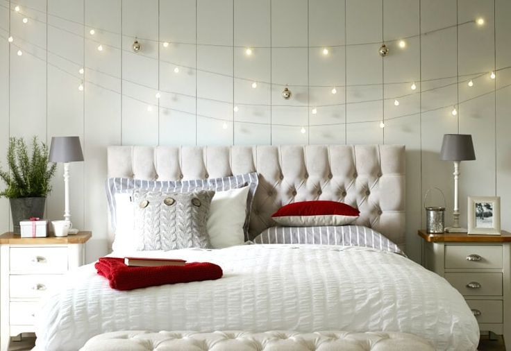 Fairy Lights Above Bed With Upholstered Headboard And White Quilt Bedroom Wall Decor Above Bed Above Bed Decor Headboard Decor