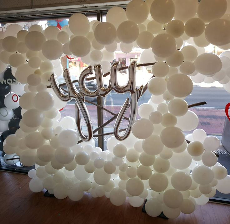 Lovely organic white balloon wall with select