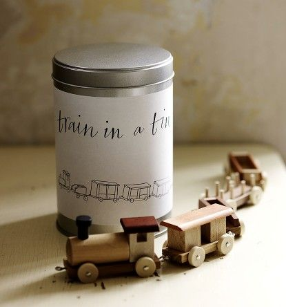 wooden train in a tin