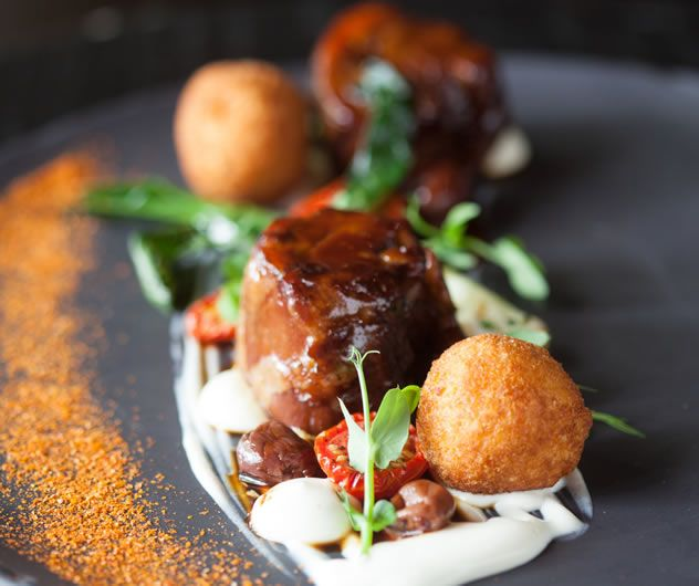 Slow braised Karoo lamb neck, tomato and mozzarella arancini, feta puree, black…