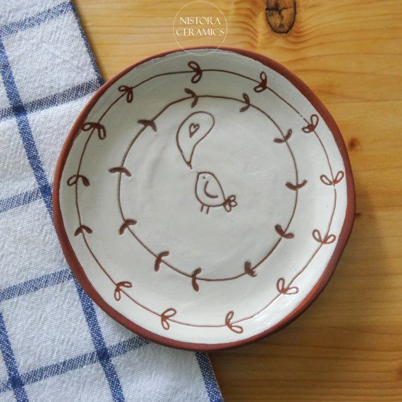 Handmade and hand decorated ceramic dish with sgraffito birdie and vines decoration