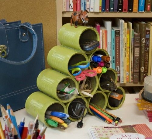 """Paint tin cans or cover them with paper or fabric. You can even hot glue them into a """"sculpture."""" Makes for great, unique storage! (Be sure cans are opened with a can opener that leaves a clean edge.)"""