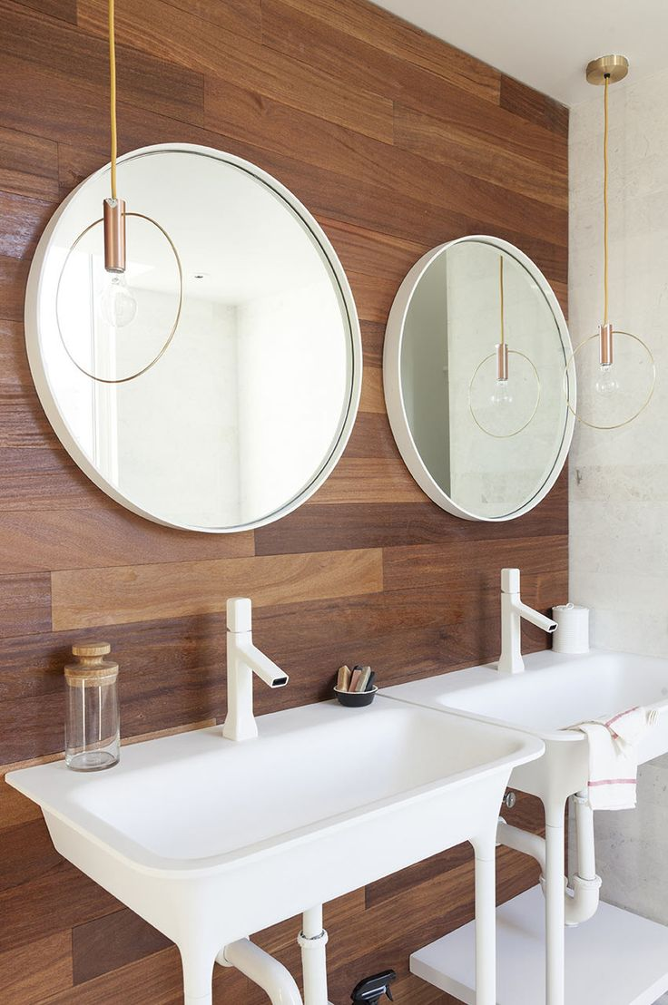 bathroom-lonny-mag.  light fixtures and surface mounted framed mirrors.