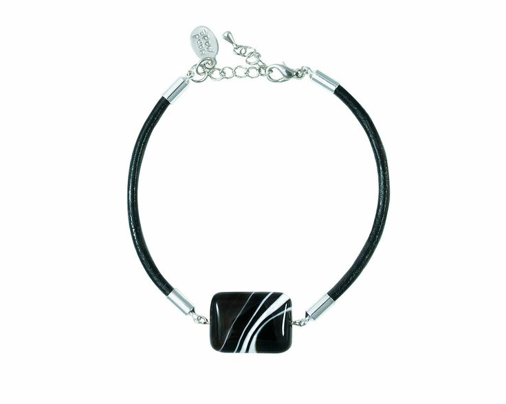 Black striped Agate bracelet is supported by a natural leather cord  with a lobster clasp closure. The bracelet has a modern and special look due to rectangular shape of the black agate with white inclusions. The semi-precious stone measure 20x15mm, the whole bracelet 18,5 cm and has a adjustable size.