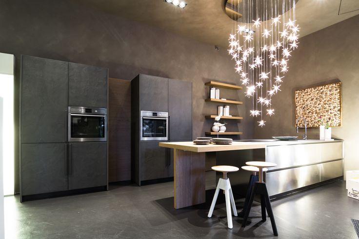 The renovated shop window of our partner Cesar Store Genova - Progetti Arredamenti: the new Maxima 2.2 combines stainless steel inox and eco cement tall-units #design #kitchen #interiors #interiordesign