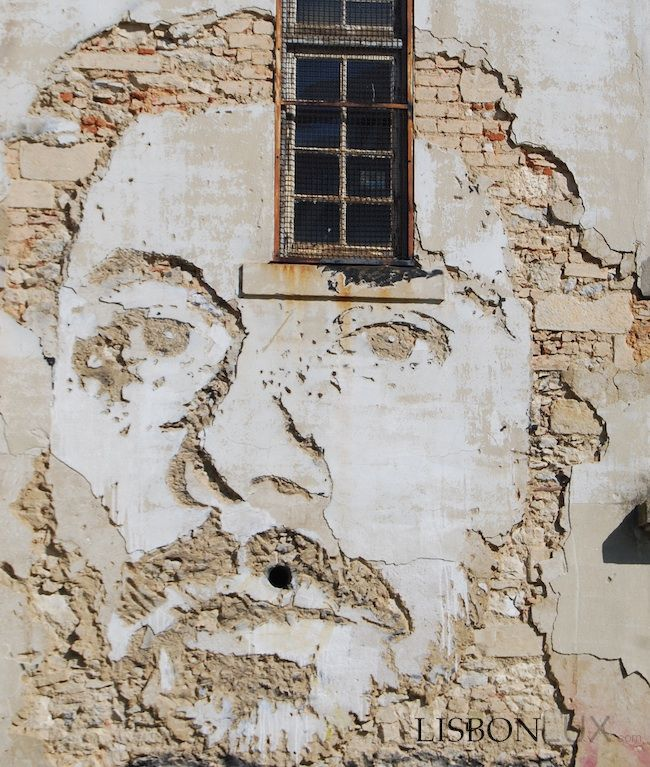 """Without the use of paints, Portuguese artist Alexandre Farto (aka """"Vhils"""") depicts, or rather, sculpts expressive faces on the walls of dila..."""