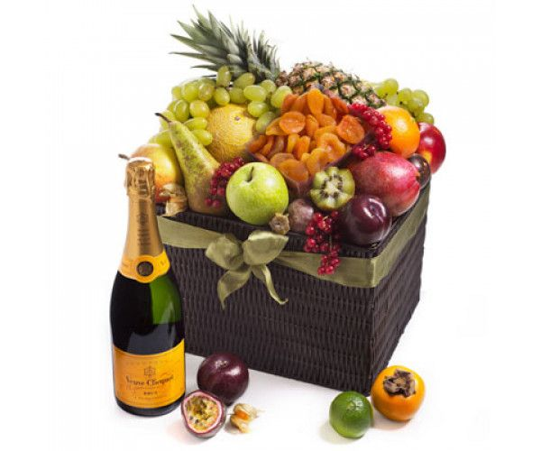 Seasonal Deluxe Exotic Fruit Hamper & Veuve Clicquot   : :    What better way to enjoy a stylish fruitbasket then with a little bubbles?Discover the richness of this combination of fresh exotic, dried and classic local fruit with the sweet aroma of French champagne Veuve Clicquot, all in one fashionable deluxe wicker hamper.