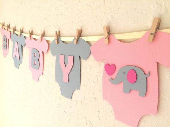 **Cute and adorable banner for baby showers!!**  This banner is a perfect touch for baby girl showers!  Pink and gray one-piece bodysuits are made of high quality heavy cardstock paper and strung on ivory satin ribbon using mini wooden clothespins. Alternating pink and gray BABY GIRL letters are mounted with pop-dots, adding that special something with a 3D look! Baby elephant with hot pink heart and ear design in the middle makes this an adorable banner for baby showers. - Each one-piece…