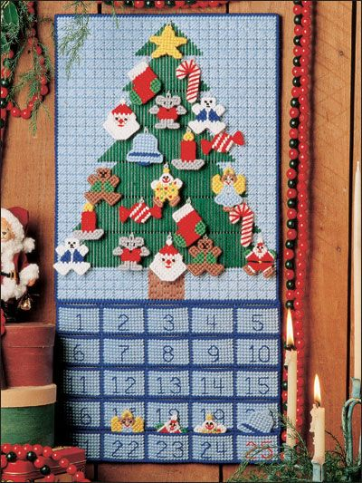 Advent Calendar Plastic Canvas Pattern Download from e-PatternsCentral.com -- Count down the days to Christmas with a charming array of sweet ornaments. A simple stitched hanger keeps each ornament in place on the tree.