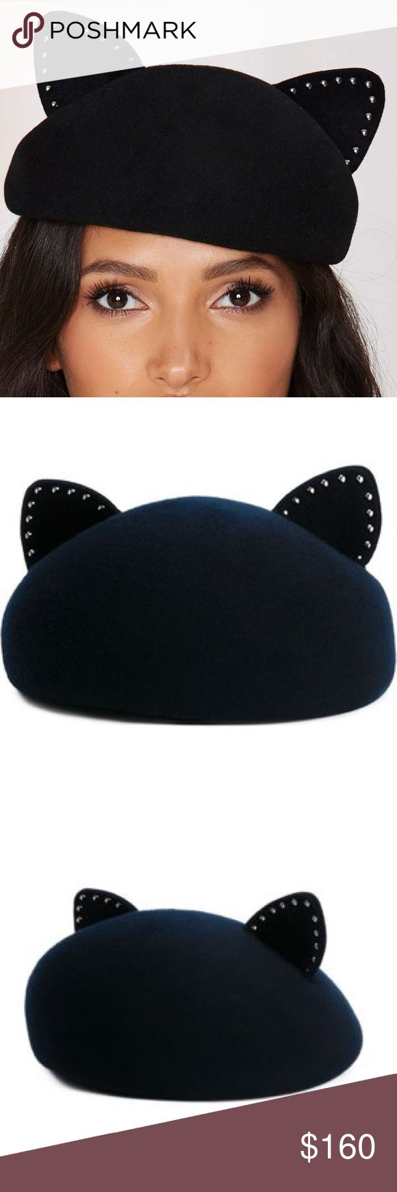 Eugenia Kim Caterina Wool Hat Eugenia Kim's Caterina Hat is made in black wool and features a cat silhouette, rounded shape, elastic chin strap, and studded ears. Eugenia Kim Accessories Hats