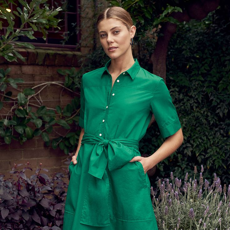 The Dress   A crisp and vibrant shirt dress update in rich green polished cotton twill with an A-line flared hem shape.