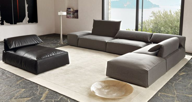 Sofa removable free-spirited and flexible   The free and flexible spirit characterizes the project FREEMOOD. It looks like a system of soft padded blocks, laid in the floor and characterized by the movement of the back, with a simple gesture goes high and pleasant. The modularity of the model is composed of elements, corners, peninsula, pouf and armrests in two different widths.
