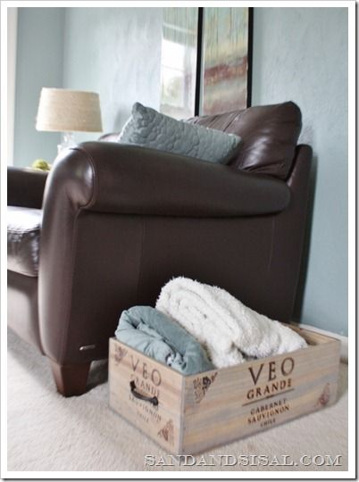 DIY wine crate storage - for blankets in the living room