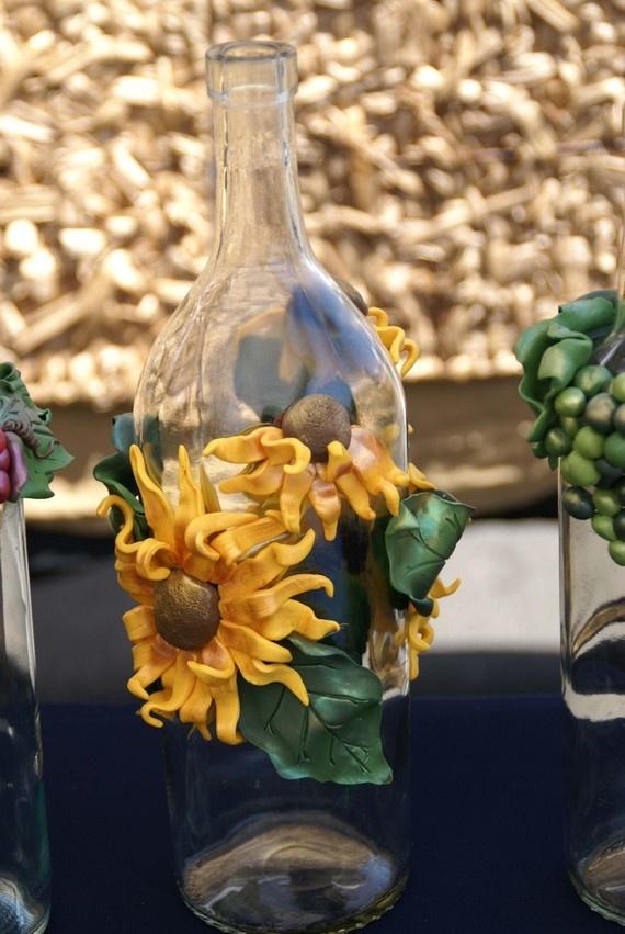 cover wine bottles in fake flowers