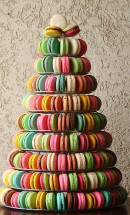 a wedding cake flnked by a macaroon tower on each side~ Macarons by Mimi