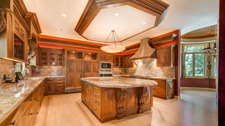 The Kitchen | Naturally, it has a guitar-shaped pool. It came as a pleasant surprise to many country fans when Reba McEntire's former estate – known affectionately as Starstruck Farms – went back on the market after being purchased by Paul H. Burch earlier this summer. Although Burch kept most of the 83-acre plot for a proposed subdivision, a 10-acre portion that includes the home where the Fancy star used to reside (and pool house, tennis courts, and barn!) went back on sale in September…