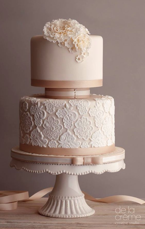 Elegant two tier blush wedding cake with lace detail; Featured Cake: De la Creme Studio
