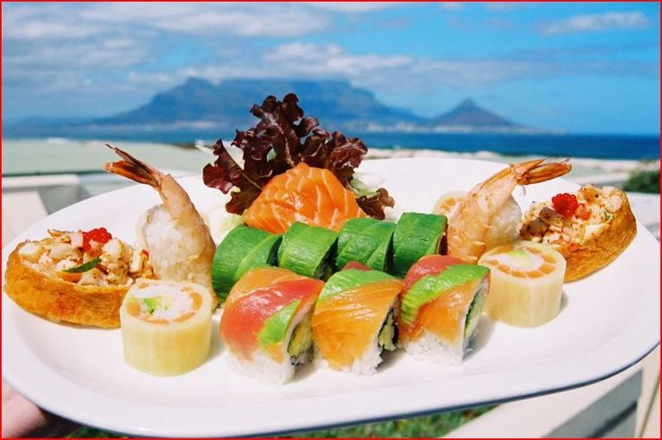 Photo: Blowfish restaurant  Blowfish Restaurant finds itself right on the coastline in Blouberg, Cape Town. Between its unforgettable views and the fresh sea breeze, you will be able to have that authentic seaside experience, all while delving into our divine seafood and sushi.  This is where your sights can be set on the Atlantic Ocean, iconic Table Mountain, Table Bay and the Cape Town City Bowl; where sounds are taken in from the ocean beside you; and where our unique flavours envelop…