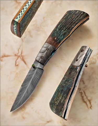 """Beautiful knife.  Persian Feather Damascus Folder by Kevin Casey. Blade and bolsters are feather damascus.  Blade length 3-3/8"""". OAL 7-1/4"""". Scales Mammoth Ivory.  Spacer and liners anodized and file-worked titanium.  Thumb-stud stone is Jade."""