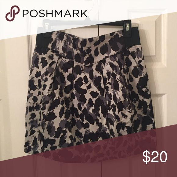 H&M Pleated Cheetah Skirt Pleated high waisted cheetah print H&M skirt. It has a stretch waist and a slight pleat to the front! Colors of black and shades of grey, in great condition! H&M Skirts Asymmetrical