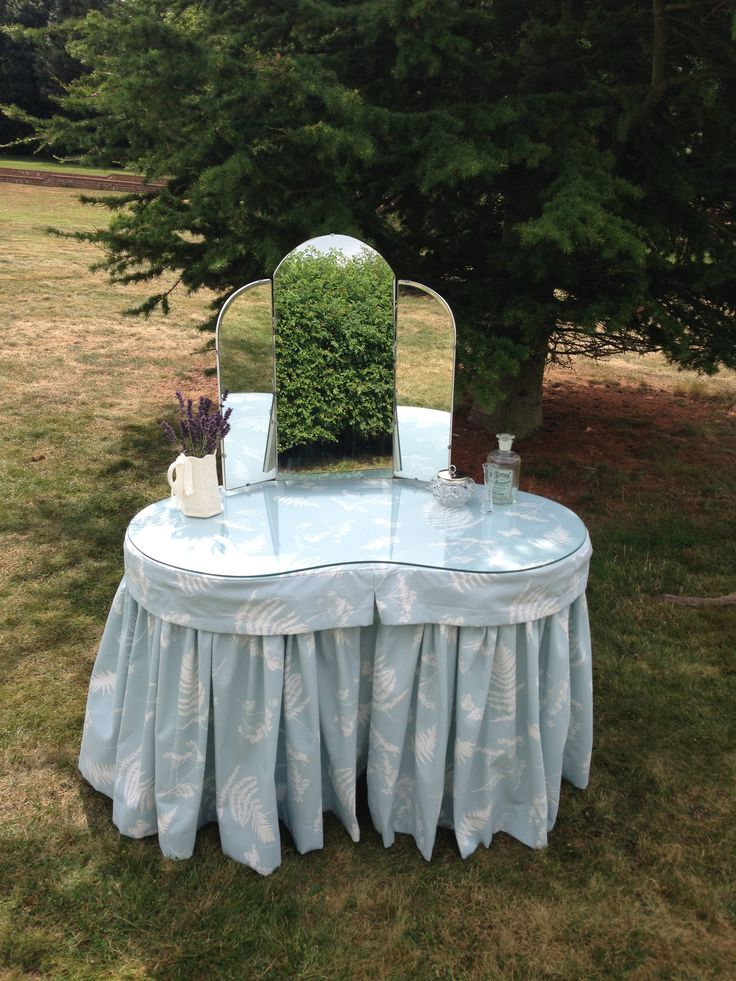Vintage kidney shaped dressing table, covered in Duck egg blue fabric by Clarke & Clarke