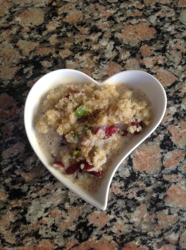 Pistachio and Cranberry Quinoa Porridge topped with Honey