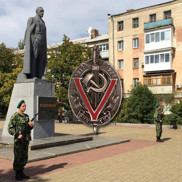 Lugansk Peoples Republic guard standing in Front of a monument for comrade Felix Dzerzhinsky, builder of the Soviet Secret police Checka