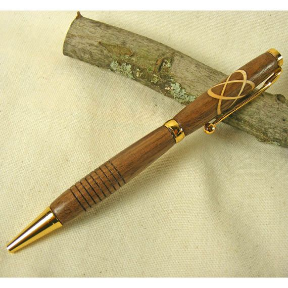 Celtic Knot Pen Made From Black Walnut With A Hard Maple Inlay. $25.00, via Etsy.