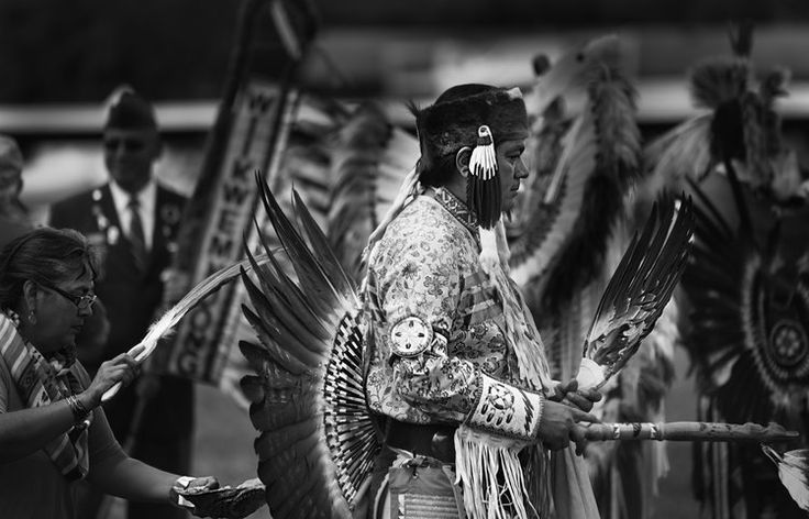"""Chief Duke is smudged with sage before the """"Grand Entry,"""" a ceremonial procession that honours and acknowledges the community elders, service people and mother earth."""