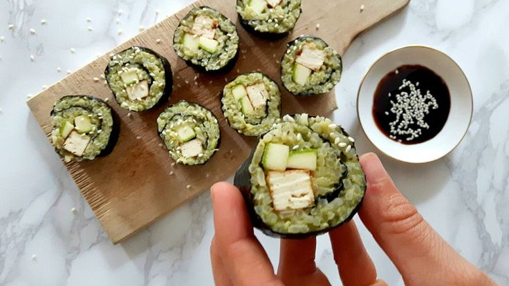 Healthy sushi made with brown rice, avocado, zucchini and tofu. Totally guilt free treat.