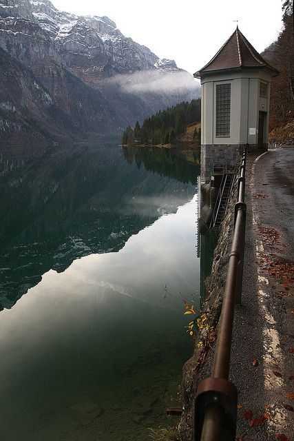 On the shores of Kl�ntalersee in Glarus, Switzerland (by Lorana Gallery).