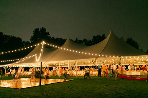 The marquee with outdoor reception space for the evening shows how the festoon lighting could work. The lighting could be draped like this with the circle of hay bales replacing the dance floor in this image.