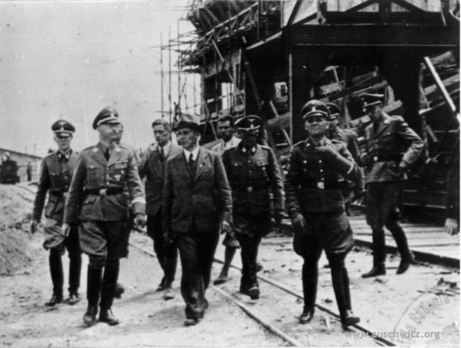 Picture taken during the visit of Heinrich Himmler in IG Farben factory in 1942. In the first row there are engineer Maximilian Faust and the Auschwitz commandant Rudolf Höss. Picture taken on July 18, 1942. (Auschwitz-Birkenau State Museum Archives)