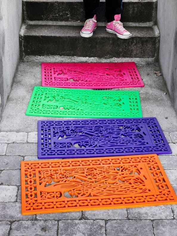 Cheap rubber mats can look downright joyful and welcoming with a bright coat of spray paint.