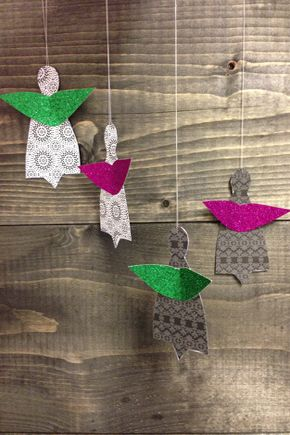 Christmas decorations Angels - Beautiful Christmas Angels do different colored paper. The wings are made of glitter paper.