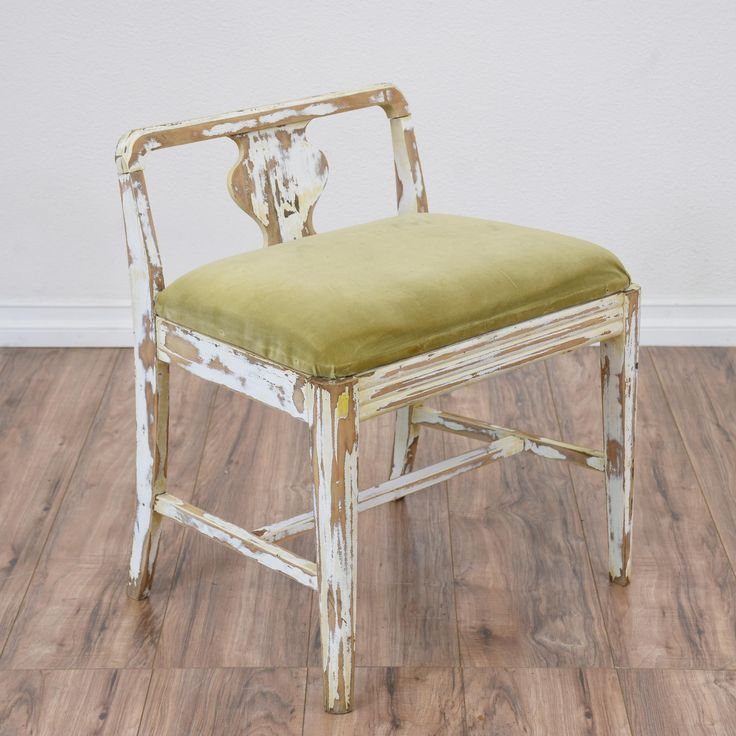 this shabby chic vanity bench is featured in a solid wood with a distressed white paint