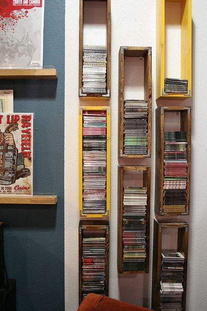 CD cases or shelves out of pallet wood. While this is a good idea as it is I started to think about it. Wouldn't it be a good idea to do variouse sizes to fit DVD's. old cassettes, videos (yes we still have a load of those). I think that would make a very interesting visual display simalar to these or screw them together as a single unit ;)