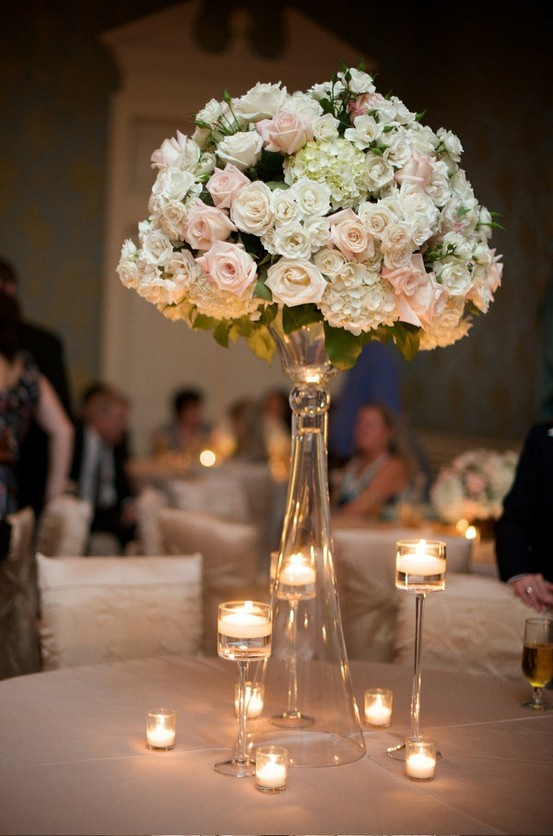 FAVORITE!!!  Tall tightly arranged centerpiece with white and blush flowers with candles all around it