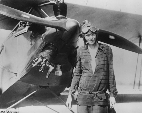 132 Super Rare and Iconic Photos Of Famous People Throughout History - Page 40 of 67 - Today's Lifestyle.....1928, AMELIA EARHART IN FRONT OF HER PLANE, FRIENDSHIP.