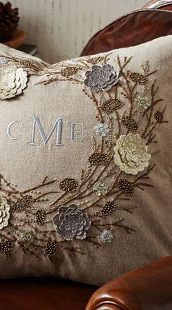 This is a Pottery Barn pillow, but would like to try and copy it with old doilies and embroidery
