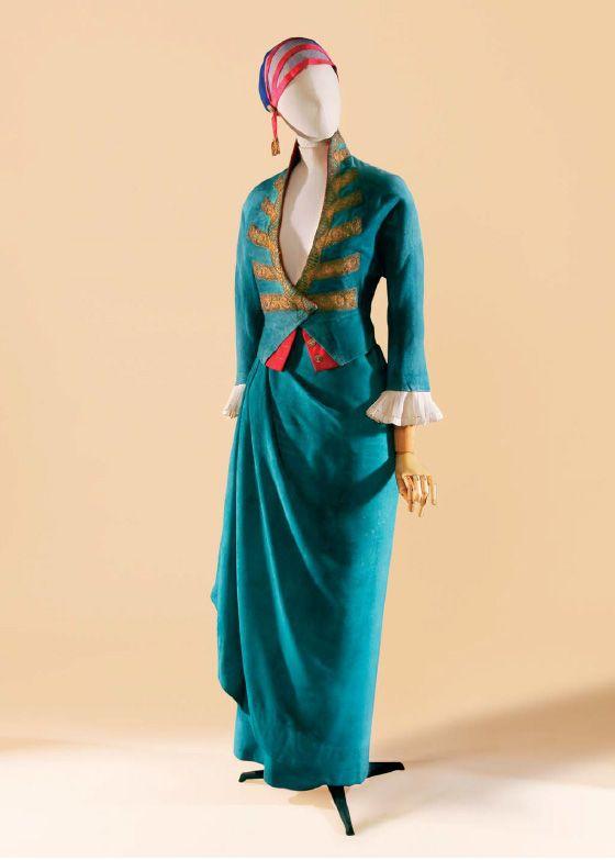 """Tailleur de dîner, modèle """" Premier consul,"""" vers 1913 by Paul Poiret - Bright teal blue dinner suit with gold and rose trim"""