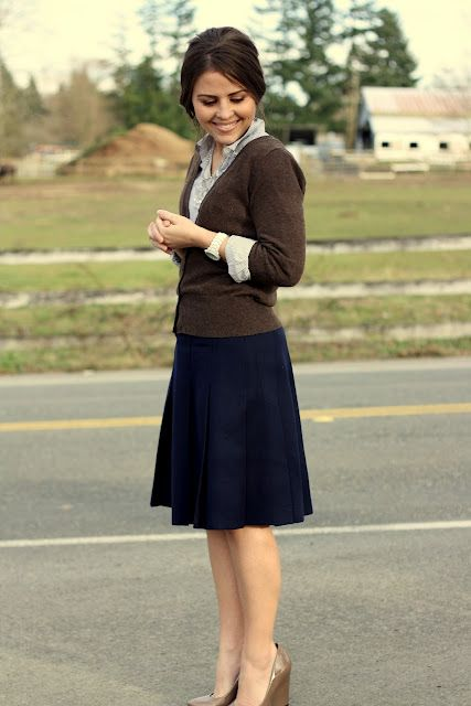 A-line navy skirt, buttoned cardigan, wedges