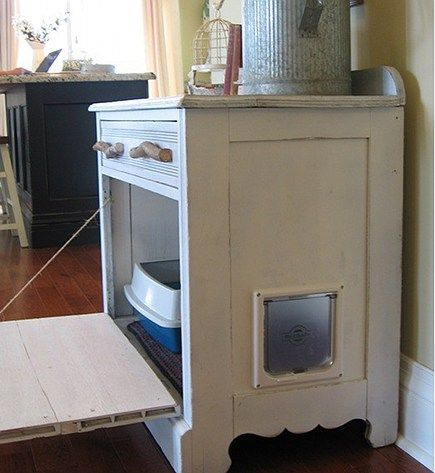 DIY hidden litter box: repurpose a vintage chest into a hidden space for the litter box: the drawer boxes were removed and the drawer fronts were attached and hinged.  A pet door was placed on the side.