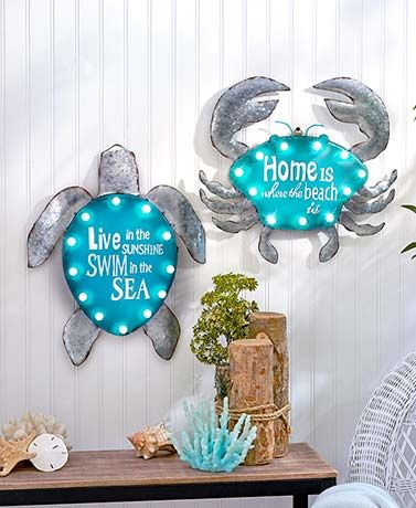 This Lighted Metal Coastal Sign has a beach-themed sentiment and a vintage marquee look for your home. The seaside-inspired sign has oversized bulbs that light up with the flip of a switch