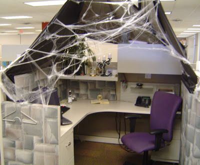 theres a contest at work for the best halloween decorated cubicle heres mine unfortunately you cant see the gargoyle on top of the sto