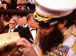Sacha Baron Cohen dumping faux ashes of late dictator Kim Jong II on Ryan Seacrest on the red carpet of the 84th Academy Awards